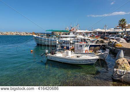 Naoussa, Paros Island, Greece - 27 September 2020: Boats And Sailing Ship Moored At The Harbor Wharf