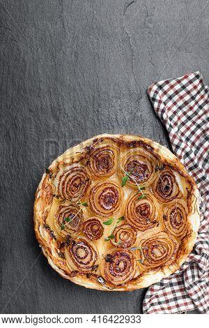 Sticky  Caramelised Onion Tart On Black Stone Backgroung