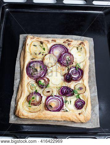 Freshly  Baked French Onion Tart On Baking Tray