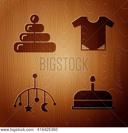 Set Cake With Burning Candles, Pyramid Toy, Baby Crib Hanging Toys And Baby Onesie On Wooden Backgro