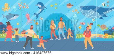 Family In Oceanarium. Parents And Kids Look At Big Glass Aquarium With Ocean Fish And Sea Animals. U