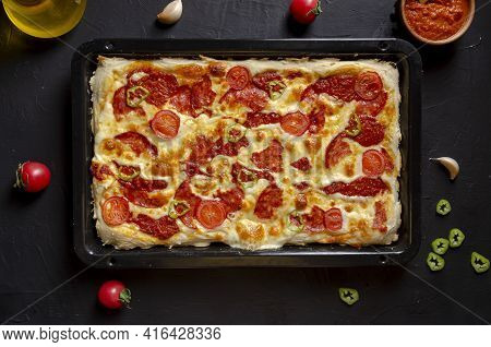 Detroit-style Pizza. Square Pepperoni Pizza With Sauce.