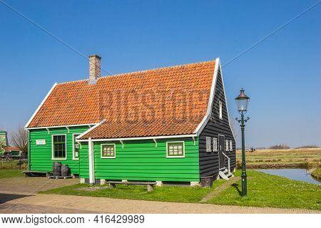 Zaanse Schans, Netherlands - March 31, 2021: Historic Green Wooden House In The Zaanse Schans Villag