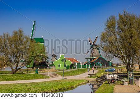 Zaanse Schans, Netherlands - March 31, 2021: Windmills And Wooden Houses In Historic Village Zaanse