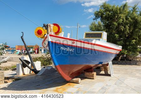 Naoussa, Paros Island, Greece - 27 September 2020: Colorful Wooden Boat On The Wharf. Palm Trees In