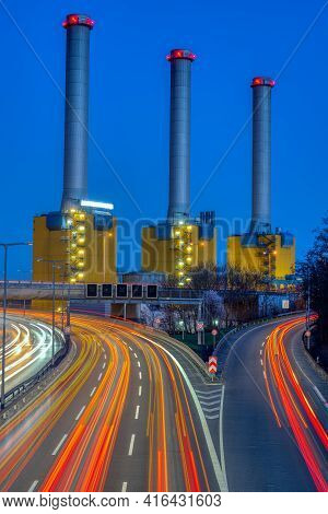 Power Station And Highway At Night Seen In Berlin, Germany
