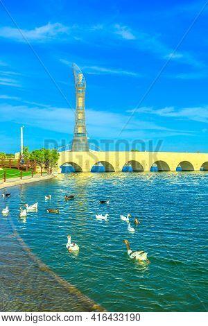Doha, Qatar - February 21, 2019: Aspire Tower Or The Torch Doha, Skyscraper Hotel, With Bridge And L