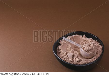 Whey Chocolate Protein Scoop. Sports Nutrition. Sports Nutrition For Building Muscles, Vitamins For
