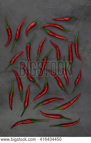 Many Red Peppers On Gray Stone Background. Chili Peppers For Cooking. Chili Peper Pattern.