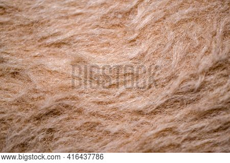 Textile Background From A Textured Brown Wool Fabric Close-up