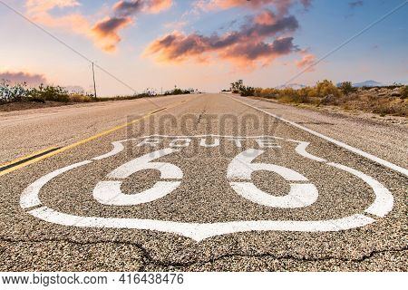 Route 66 Road Sign With Blue Sky Background. Historic Street With Nobody. Classic Concept For Travel