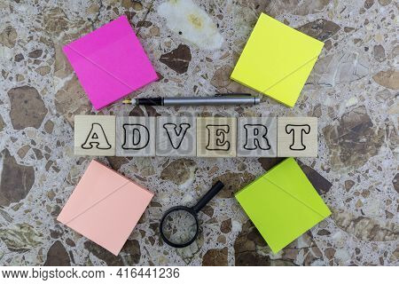 Advert Or Advertising Concept With Multicolored Memo Pads, Pen And Magnifying Glass Surrounding Cent