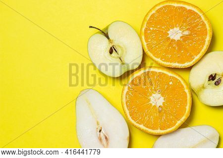 Sliced Fruits On A Yellow Background. Healthy Diet. Fruit Theme. Bright Fruit