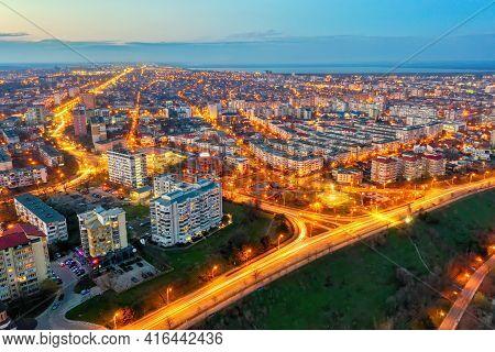 Galati, Romania - March 19, 2021: Aerial View Of Galati City, Romania. Night City Lights After Sunse