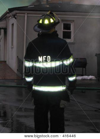 Fireman At House Fire