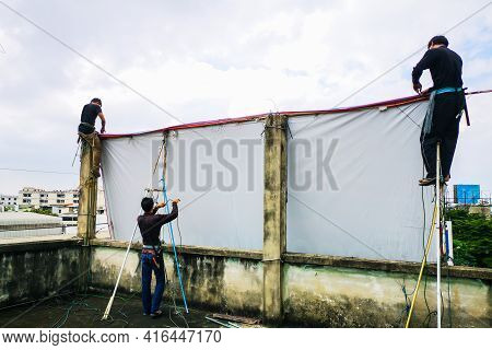 Workers Prepare Billboards To Install New Ads.