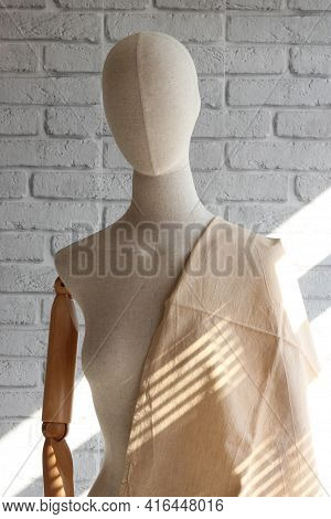 Professional Tailoring Mannequin. Female Mannequin With Wooden Hands On Wall Background For Displayi