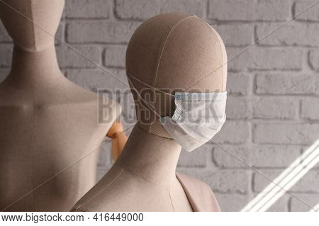 Modern Fabric Mannequin In A Protective Mask. Demonstration Of Clothes On Mannequins During The Coro