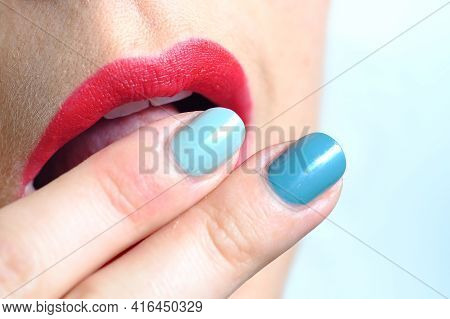 Close Up Of Pastel And Green Fingernails Touching Beautiful And Sensual Red Lips