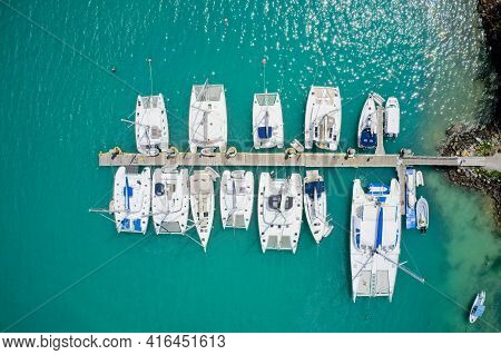 Aerial View From Directly Above Of Expensive Yachts And Jetty Praslin, Seychelles.