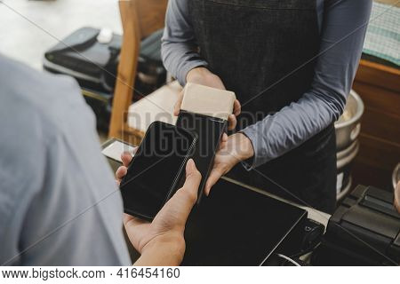 Young Customer Using Digital Mobile Phone Scan Bar Code Pay For Buying Coffee In Modern Cafe Coffee