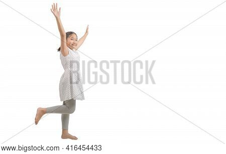 Kid Girl Raise Her Hand And Raise One Leg Isolated On White Background., Happy And Victory Concept