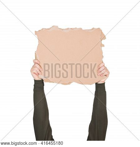 Activist Hands Holding Up A Blank Cardboard Sheet, Engaged In A Street Demonstration Or Protest. Bla