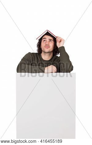 Doubtful Young Man Student, Thinking With A Book On His Head, Leaning Puzzled On A Blank Announcemen