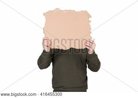 Anonymous Man Covers His Head With A Blank Cardboard Sheet, Copy Space For Messages. Empty Banner Fo