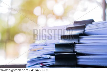 Piles Of Stack Unfinished Documents Reports Files With Overwork Paperwork On Teacher Desk. Messy She