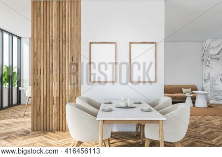 Bright Modern Dining Room Interior With Four Cozy Armchair, Two Empty Blank Posters On White Wall, W