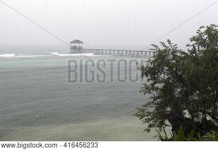 Kadidiri, Indonesia - August 18, 2017: View Of Pier In Rainy Day, Togian Islands