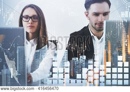 Businessman And Businesswoman Or Stock Traders Analyzing Stock Data To Apply New Strategy To Beat Th