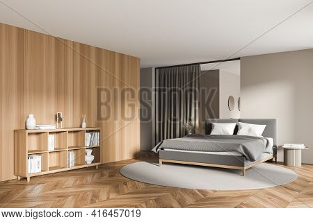 Contemporary Cozy Bedroom Interior With Large Comfortable Grey Bed, Beige And Wooden Walls, Round Ca