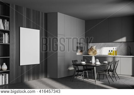 Dark Contemporary Kitchen Room Interior With Dining Table, Cupboard, Empty White Poster On The Wardr