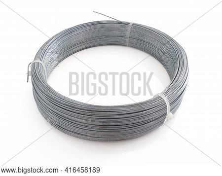 Silver Wire Coil Isolated On White Background. Aerial View Of Industry Coil Of Galvanized Wire For B