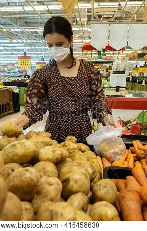 Alarmed Female Wears Medical Mask Against Coronavirus While Shopping In Store- Health, Safety And Pa