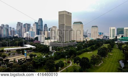 Aerial View Of Buildings In The City Of Jakarta And Noise Cloud With Jakarta Cityscape. Jakarta - In