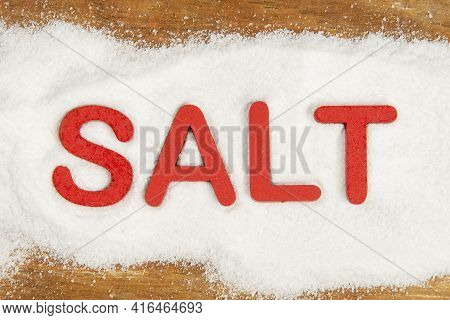 Word Salt Written In Red On The Product Formed A Band