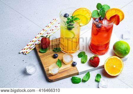 Two Glasses Of Refreshing Summer Lemonade With Ice. Cocktail With Strawberry And Lemon And Cocktail