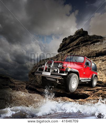 Offroad vehicle on the wild nature mountain terrain poster