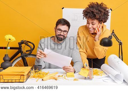 Satisfied Diverse Woman And Man Have Fun In Office While Preparing Creative Project Collaborate For