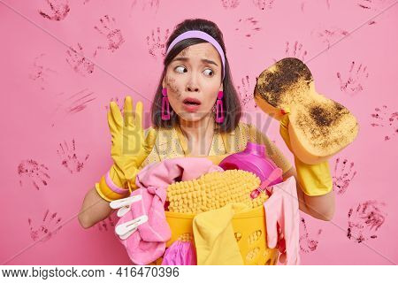 Puzzled Asian Housekeeper Tries To Keeps Home Bright And Clean Shocked How Much Dust Is In Room Look