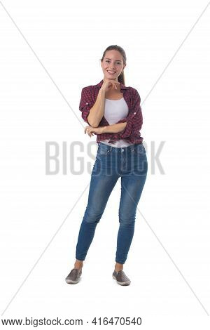 Full Length Portrait Of Smiling Young Woman With Her Hand On Chin Isolated On White Background, Casu