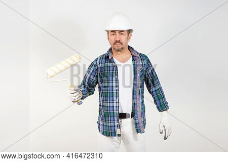 A Builder Repairman Holds A Paint Roller In His Hand On A White Background Wall, Construction Templa