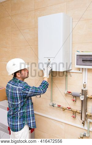 Builder, Repairman, Plumber Turns On The Water Heater, Autonomous Heating System In The House