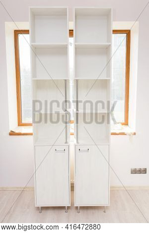 Cabinet Furniture, Two Light Wardrobe Sections In An Empty Room