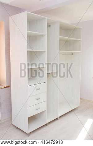 Cabinet Furniture, Light-colored Wardrobe In The Room After Renovation