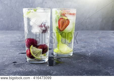 Mojito Cocktail With Ice Cubes. Glasses Of Various Summer Lemonade Or Ice Tea. Refreshing Cool Detox