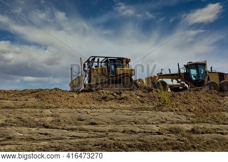 The Works On Construction Excavators Of New Road A Level The Ground Road Construction Equipment Of M